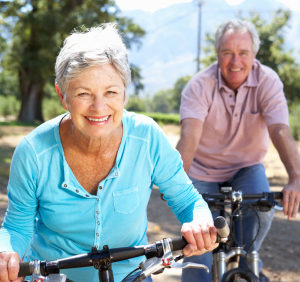 senior couple diring a bicycle